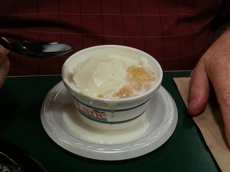Warm peachy cobbler, melting ice cream, already half gone.