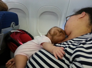 Sleeping child, sleeping mother.  Peace for the whole plane.
