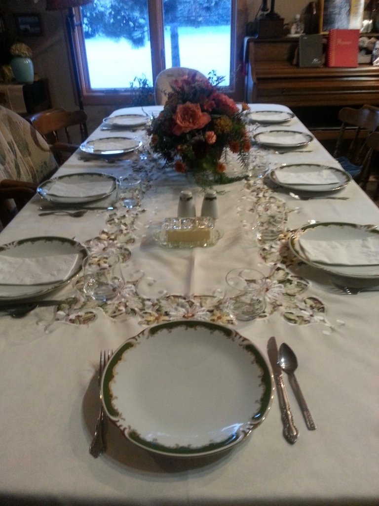 Before the feast - one of our two tables with Mom's birthday flowers as the centerpiece.