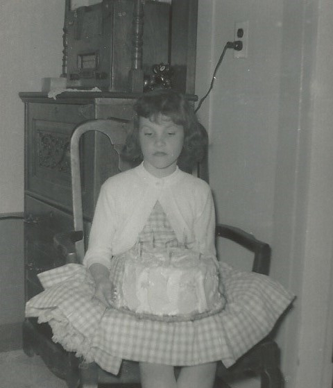 Oh please, another birthday? Can't you take a picture of me when I feel like smiling? Nice cake though.