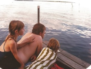 My girls and their dad enjoying a moment on the dock after a swim.