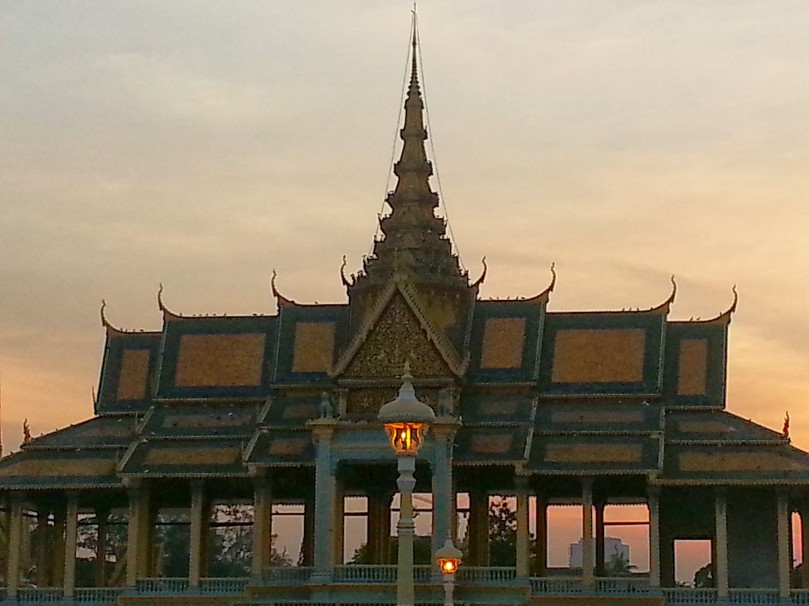 Palace building in the sunset, along Mekong riverfront park, Phnom Pehn.