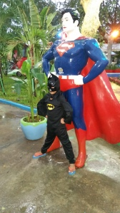 "Our very own ""Batman"" posing with a superhero friend."