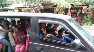 5 adults and 20 + children manage to travel happily in this van (that is not to say they couldn't use a little more room...)
