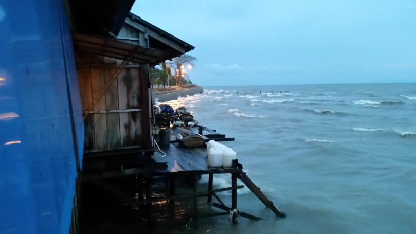 At Kimmly Seafood Restaurant in Kep, angry sea, beautiful night sky.