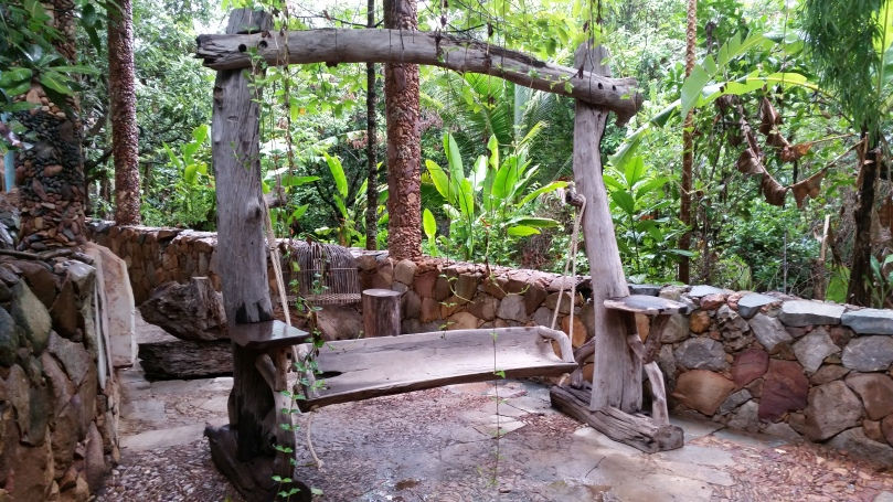 Swing seating made of natural wood pieces